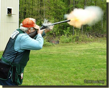 Jim Pottee breaking the high-house four clay with a muzzle loading shotgun.